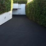 Aplicación de aglomerado asfaltico en caliente con medios mecánicos y sellado con 2 capas de slurry sintético con resinas antideslizantes