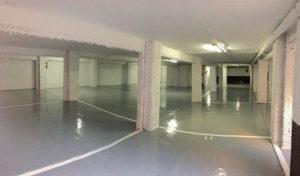 Asfaltar el parking y pintar el pavimento con resinas